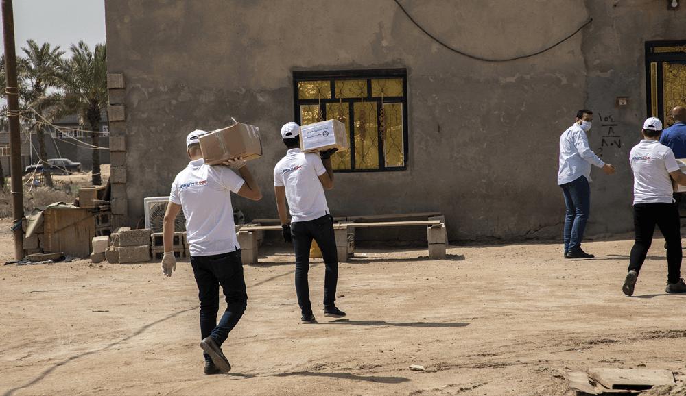 توزيع سلال ايرثلنك الغذائية خلال أيام حظر التجوال